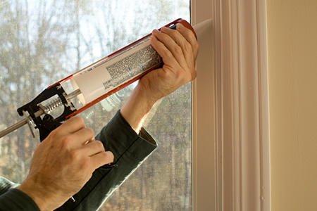 Koopman caulking door frame & Insulating your Doors - Koopman Blog