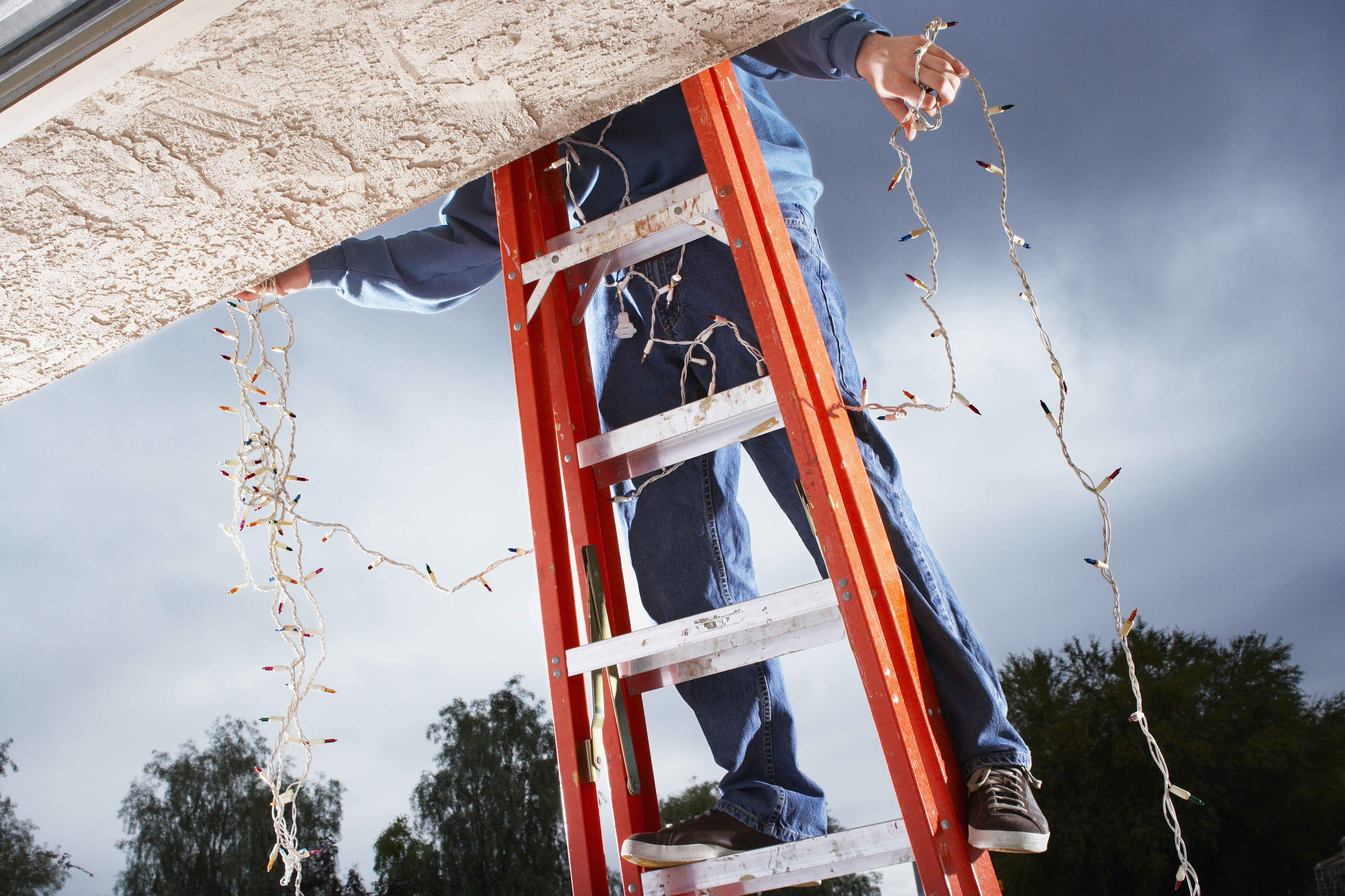 Hanging holiday lights puts your feet in danger...proceed with caution or hire a pro!