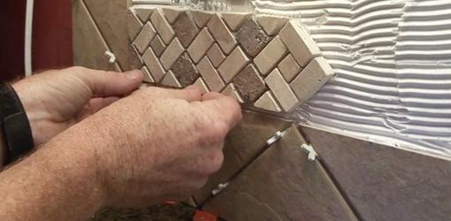installing ceramic tiles on a kitchen backslash