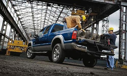 Men Loading A Pickup Truck