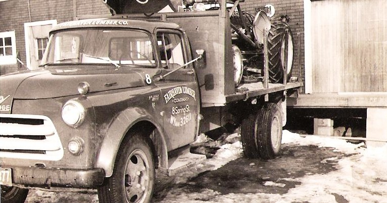 Fairhaven Lumber Truck Hauling a Tractor Circa 1950s